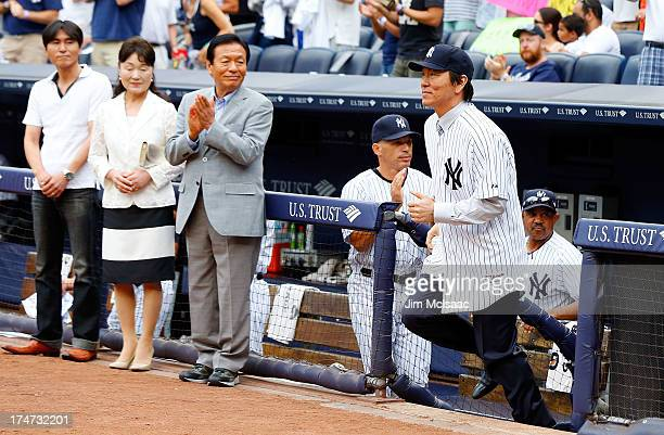 Former New York Yankee Hideki Matsui is introduced to throw out the ceremonial first pitch before a game against the Tampa Bay Rays as his father...