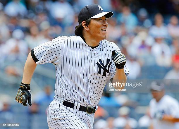 Former New York Yankee Hideki Matsui participates during the teams Old Timers Day prior to a game between the New York Yankees and the Baltimore...