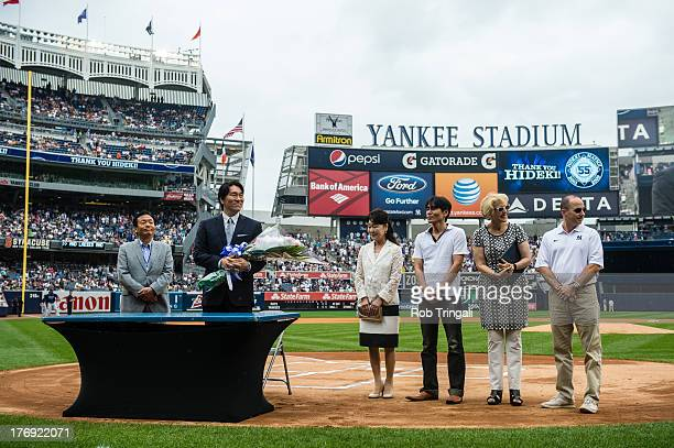 Former New York Yankee Hideki Matsui stands during a ceremony before the game between the New York Yankees and the Tampa Bay Rays as his father Masao...