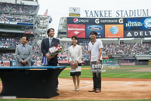 Former New York Yankee Hideki Matsui stands during a pre game ceremony before a game between the New York Yankees and the Tampa Bay Rays as his...