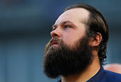 Former New York Yankee Joba Chamberlain of the Detroit Tigers looks on the from dugout priro to the game against the New York Yankees at Yankee...