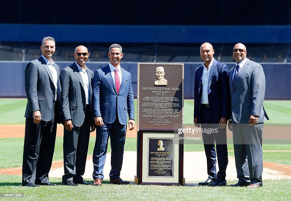 Former New York Yankee Jorge Posada (C) poses with his Monument Park plaque during a ceremony before a game against the Cleveland Indians with former teammates, from left, Andy Pettitte, Mariano Rivera, Derek Jeter and Bernie Williams at Yankee Stadium on August 22, 2015 in the Bronx borough of New York City.
