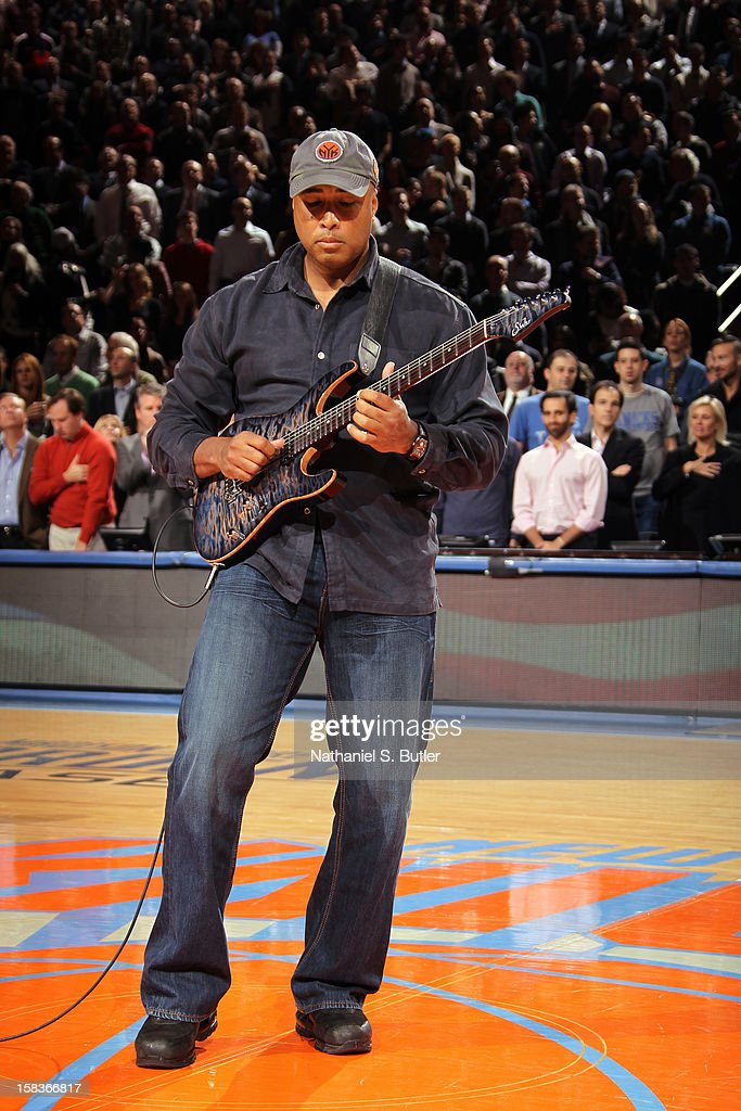 Former New York Yankee player Bernie Williams entertains the crowd during the game between the New York Knicks and Los Angeles Lakers on December 13, 2012 at Madison Square Garden in New York City.