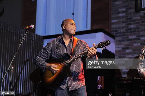 Former New York Yankee player Bernie Williams plays guitar on stage in front of 1400 fans and fellow Cactus League players during Jake Peavy's...