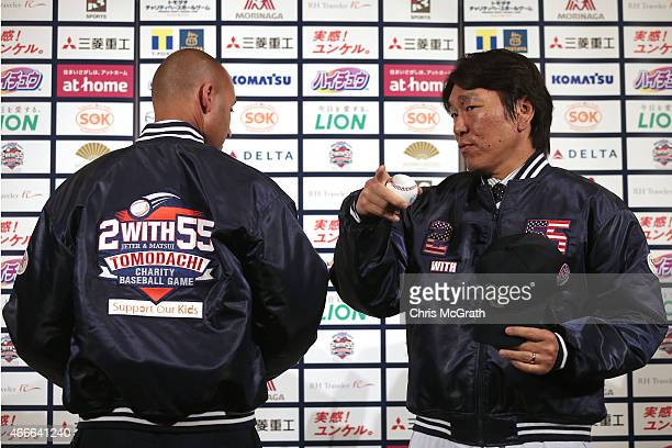 Former New York Yankee player Hideki Matsui directs former team mate Derek Jeter towards photographers during a press conference about the 'Tomodachi...