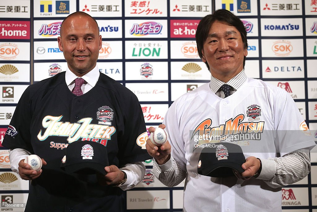 Former New York Yankee players Derek Jeter (L) and Hideki Matsui pose for photographers during a press conference about the 'Tomodachi Charity Baseball Game' on March 18, 2015 in Tokyo, Japan. At the charity event on March 21, 2015, an auction party will be held to raise funds for the Tsunami and Earthquake hit Tohoku area, Japanese professional players will teach children from the Tohoku area, and Matsui and Jeter will battle in the home-run derby.