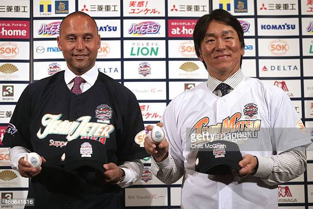 Former New York Yankee players Derek Jeter and Hideki Matsui pose for photographers during a press conference about the 'Tomodachi Charity Baseball...