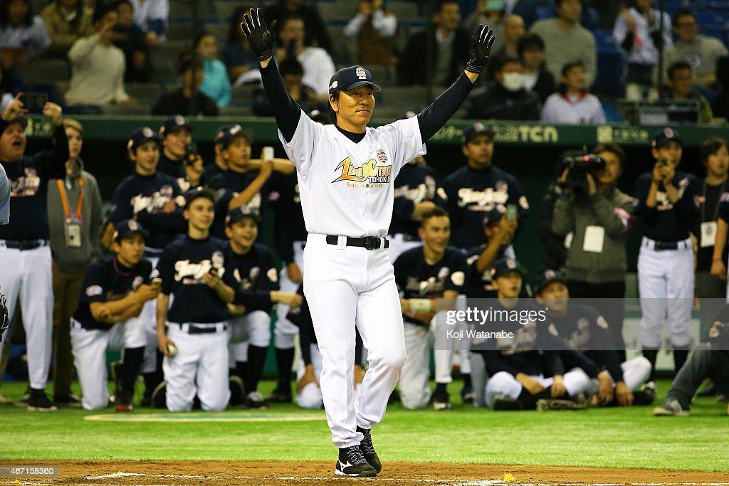 Former New York Yankee players Hideki Matsui Charity Baseball Game celebrates a homer after scoring during the Tomodachi Charity Baseball Game on March 21, 2015 in Tokyo, Japan.