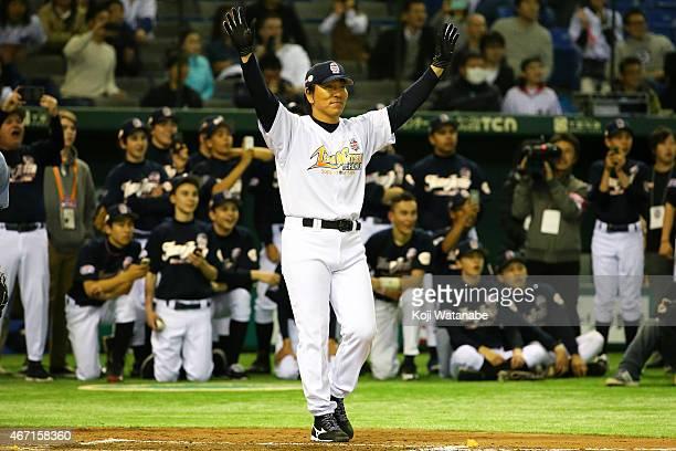 Former New York Yankee players Hideki Matsui Charity Baseball Game celebrates a homer after scoring during the Tomodachi Charity Baseball Game on...