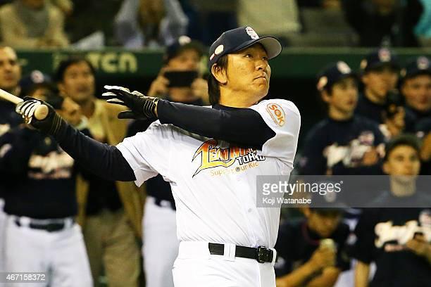 Former New York Yankee players Hideki Matsui Charity Baseball Game hits a homer during the Tomodachi Charity Baseball Game on March 21 2015 in Tokyo...