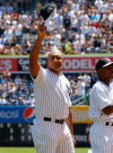 Former New York Yankees Bernie Williams is introduced during the teams 67th Old Timers Day prior to a game against the Tampa Bay Rays at Yankee...