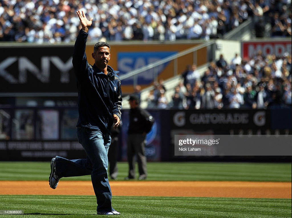 Former New York Yankees catcher <a gi-track='captionPersonalityLinkClicked' href=/galleries/search?phrase=Jorge+Posada&family=editorial&specificpeople=202157 ng-click='$event.stopPropagation()'>Jorge Posada</a> waves to the crowd after throwing out the ceremonial first pitch during the Yankees' home opener against the Los Angeles Angels at Yankee Stadium on April 13, 2012 in the Bronx borough of New York City.