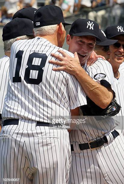 Former New York Yankees Don Larsen and David Cone share a moment during the teams 64th OldTimer's Day before the MLB game against the Tampa Bay Rays...