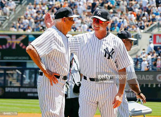 Former New York Yankees Don Larsen and Rich 'Goose' Gossage are introduced during the teams 67th Old Timers Day prior to a game against the Tampa Bay...