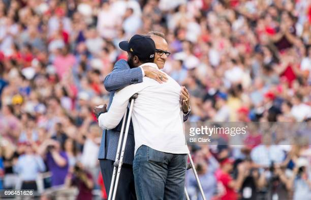 Former New York Yankees manager Joe Torre gives a hug to David Bailey one of the the injured Capitol Police officers on Rep Steve Scalise's security...