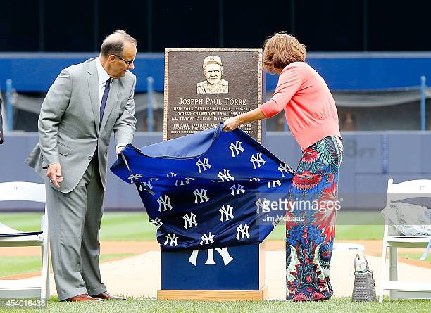 Former New York Yankees manager Joe Torre unviels his plaque that will be installed in Monument Park with his wife Ali at Yankee Stadium during a...