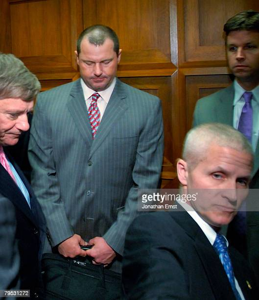 Former New York Yankees pitcher Roger Clemens departs on an elevator after being deposed by the House Oversight and Government Reform Committee about...