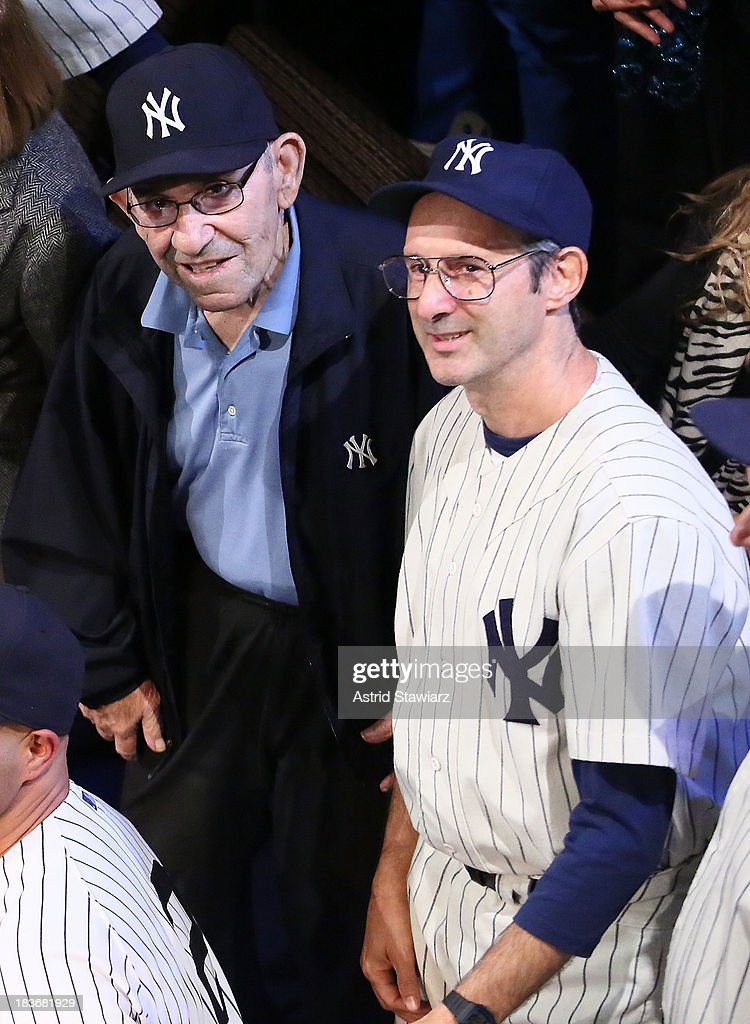 Former New York Yankees player and manager <a gi-track='captionPersonalityLinkClicked' href=/galleries/search?phrase=Yogi+Berra&family=editorial&specificpeople=94270 ng-click='$event.stopPropagation()'>Yogi Berra</a> poses with actor Richard Topol during 'Bronx Bombers' Opening Night Curtain Call at Primary Stages on October 8, 2013 in New York City.
