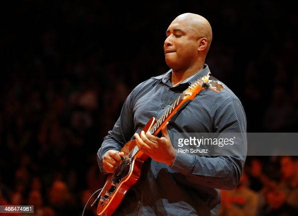Former New York Yankees' player Bernie Williams performs the national anthem before a game between the Miami Heat and the New York Knicks at Madison...