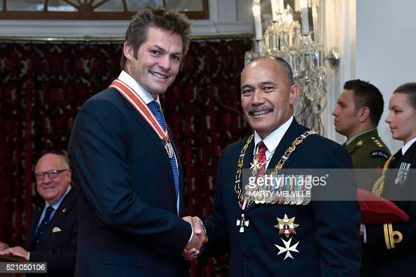 Former New Zealand All Black captain Richie McCaw receives the Order of New Zealand from Governor General Lieutenant General Jerry Mateparae during...