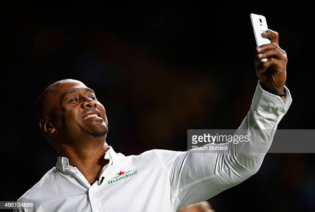 Former New Zealand All Black Jonah Lomu takes a selfie during the 2015 Rugby World Cup Final match between New Zealand and Australia at Twickenham...