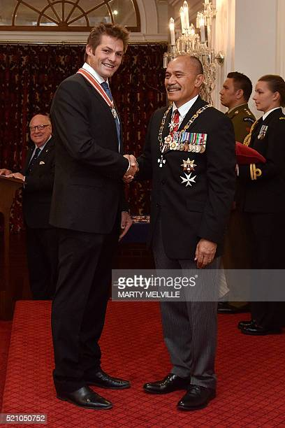 Former New Zealand All Blacks rugby union captain Richie McCaw receives the Order of New Zealand from Governor General Lieutenant General Jerry...