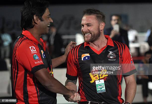 Former New Zealand captain Brendon McCullum and playing for Lahore Qalandars shakes hands with former Pakistani cricketer Aqib Javed during the...