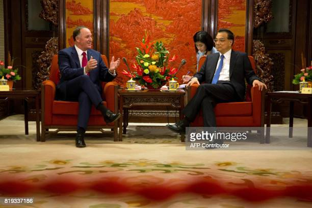 Former New Zealand prime minister John Key and Chinese Premier Li Keqiang talk during a meeting at the Zhongnanhai Leadership compound in Beijing on...