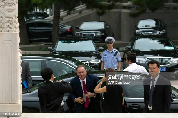 Former New Zealand prime minister John Key arrives for a meeting with Chinese Premier Li Keqiang at the Zhongnanhai Leadership compound in Beijing on...