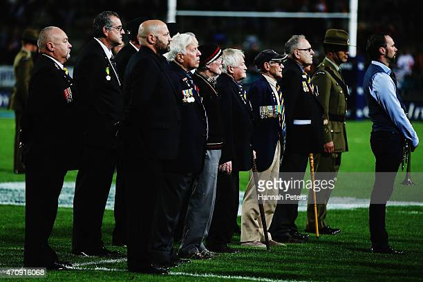 Former New Zealand servicemen observe a moment of silence to mark the significance of Anzac Day prior to the round 11 Super Rugby match between the...