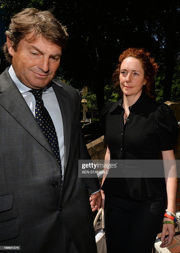 Former News International chief executive Rebekah Brooks (R), and her husband Charlie Brooks (L) leave Southwark Crown Court in London on June 5, 2013 during a hearing into charges linked to the phone-hacking scandal. Rebekah Brooks, Former chief executive of Rupert Murdoch's British newspaper wing News International, pleaded not guilty on June 5 to charges linked to the phone-hacking scandal that brought down his News of the World tabloid. Brooks, 45, denied five charges including conspiracy to hack phones, conspiracy to commit misconduct in a public office and conspiracy to pervert the course of justice. She appeared in a packed courtroom in London alongside several other former News International staff and her husband Charlie Brooks, who are also accused of conspiring to pervert the course of justice by hiding evidence relating to the hacking scandal. AFP PHOTO / BEN STANSALL