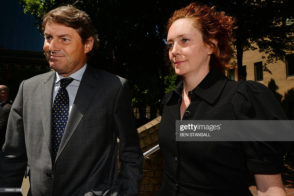 Former News International chief executive Rebekah Brooks (R), and her husband Charlie Brooks (L) leave Southwark Crown Court in London on June 5, 2013 after a hearing into charges linked to the phone-hacking scandal. Rebekah Brooks, Former chief executive of Rupert Murdoch's British newspaper wing News International, pleaded not guilty on June 5 to charges linked to the phone-hacking scandal that brought down his News of the World tabloid. Brooks, 45, denied five charges including conspiracy to hack phones, conspiracy to commit misconduct in a public office and conspiracy to pervert the course of justice. She appeared in a packed courtroom in London alongside several other former News International staff and her husband Charlie Brooks, who are also accused of conspiring to pervert the course of justice by hiding evidence relating to the hacking scandal.