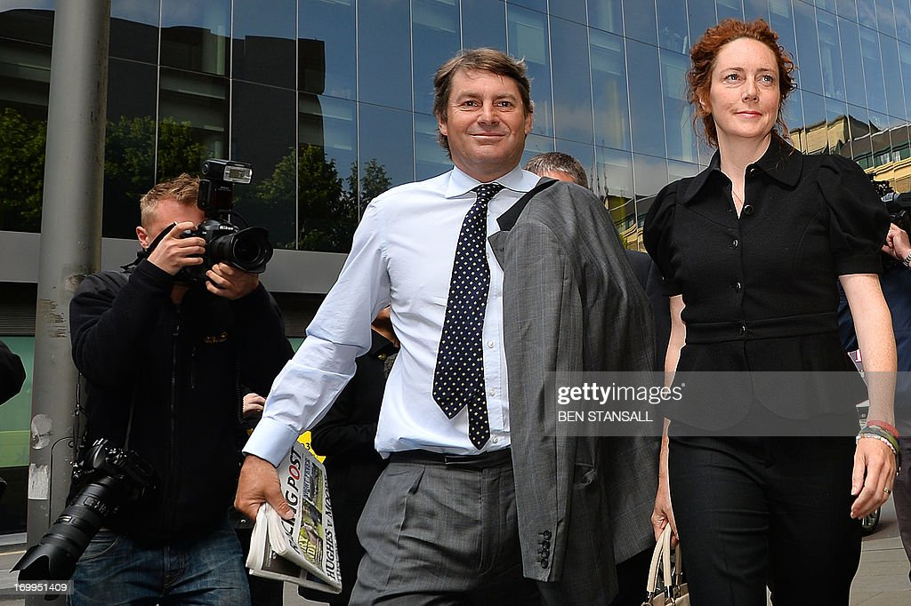 Former News International chief executive Rebekah Brooks (R) and her husband Charlie Brooks (L) leave Southwark Crown Court in London on June 5, 2013 after attending a hearing into charges linked to the phone-hacking scandal. Rebekah Brooks, former chief executive of Rupert Murdoch's British newspaper wing News International, pleaded not guilty on June 5 to charges linked to the phone-hacking scandal that brought down his News of the World tabloid. Brooks, 45, denied five charges including conspiracy to hack phones, conspiracy to commit misconduct in a public office and conspiracy to pervert the course of justice. She appeared in a packed courtroom in London alongside several other former News International staff and her husband Charlie Brooks, who are also accused of conspiring to pervert the course of justice by hiding evidence relating to the hacking scandal.