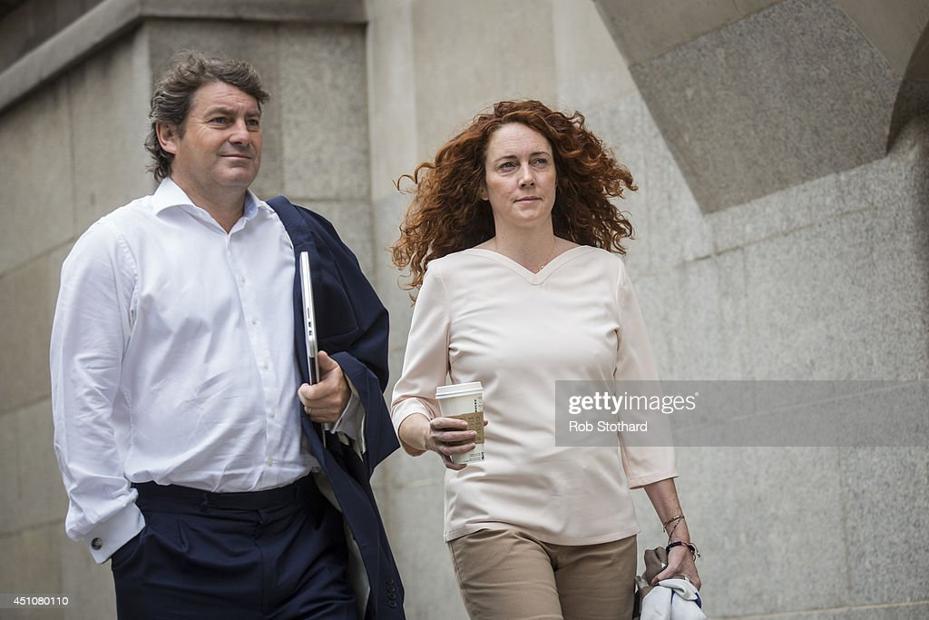 Former News International chief executive <a gi-track='captionPersonalityLinkClicked' href=/galleries/search?phrase=Rebekah+Brooks&family=editorial&specificpeople=6848116 ng-click='$event.stopPropagation()'>Rebekah Brooks</a> and her husband <a gi-track='captionPersonalityLinkClicked' href=/galleries/search?phrase=Charlie+Brooks+-+Racehorse+Trainer&family=editorial&specificpeople=11680647 ng-click='$event.stopPropagation()'>Charlie Brooks</a> arrive at the Old Bailey on June 23, 2014 in London, England. Downing Street's former director of communications and News Of The World editor Andy Coulson and the former News International chief executive <a gi-track='captionPersonalityLinkClicked' href=/galleries/search?phrase=Rebekah+Brooks&family=editorial&specificpeople=6848116 ng-click='$event.stopPropagation()'>Rebekah Brooks</a>, along with six others, face a series of charges linked to the phone hacking of celebrities and others at the now-defunct newspaper.