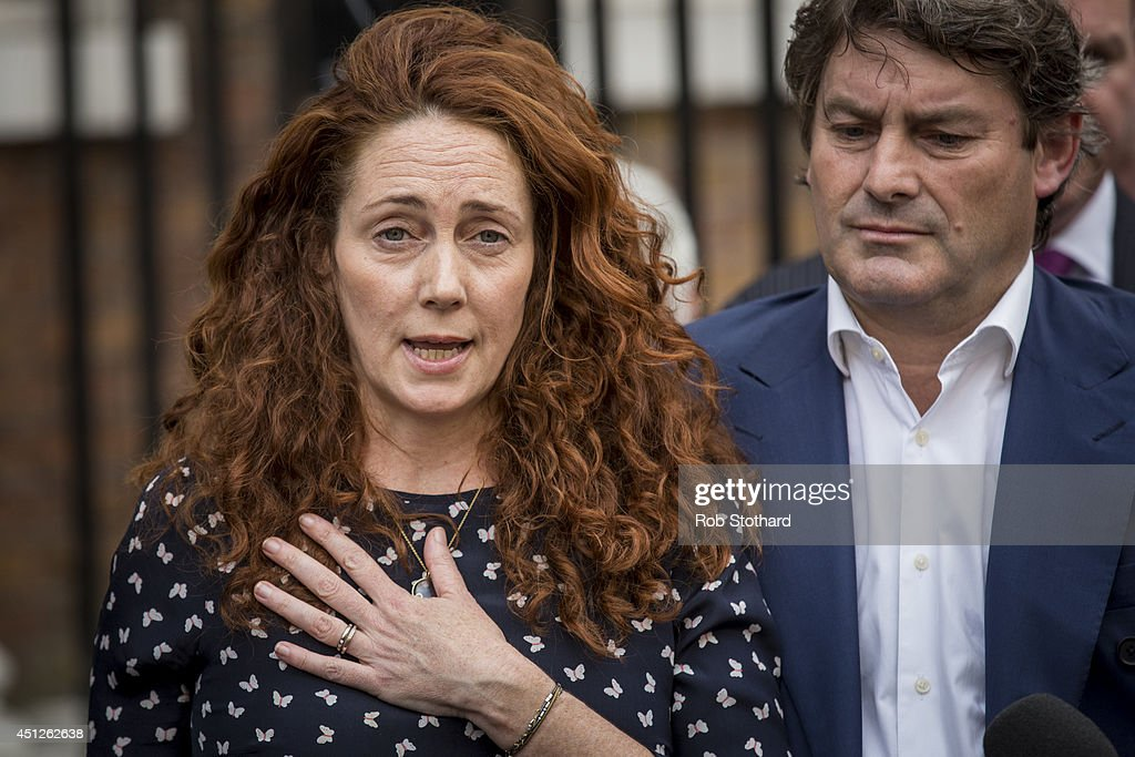 Former News International chief executive <a gi-track='captionPersonalityLinkClicked' href=/galleries/search?phrase=Rebekah+Brooks&family=editorial&specificpeople=6848116 ng-click='$event.stopPropagation()'>Rebekah Brooks</a> and her husband Charlie Brooks give a statement outside their home on June 26, 2014 in London, England. Rebekah and Charles Brooks have been acquitted of phone hacking charges. Former government Director of Communications and News of The World editor Andy Coulson has been found guilty of conspiracy to hack phones after the eight month trial at the Old Bailey. The charges of phone hacking were brought by numerous celebrities and members of the public against the media company and forced the closure of the News of the World newspaper.
