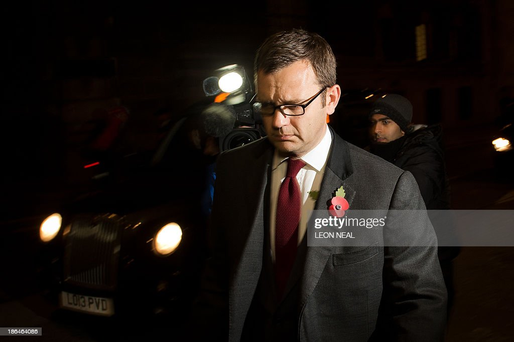 Former News of the World editor and Downing Street communications chief Andy Coulson leaves the Old Bailey court in London on October 31, 2013 after another day's hearing in the phone hacking trial. Former News of the World editors Rebekah Brooks and Andy Coulson were having an affair throughout much of the time they were allegedly involved in phone hacking at the Rupert Murdoch-owned tabloid, their trial heard on October 31. AFP PHOTO / LEON NEAL