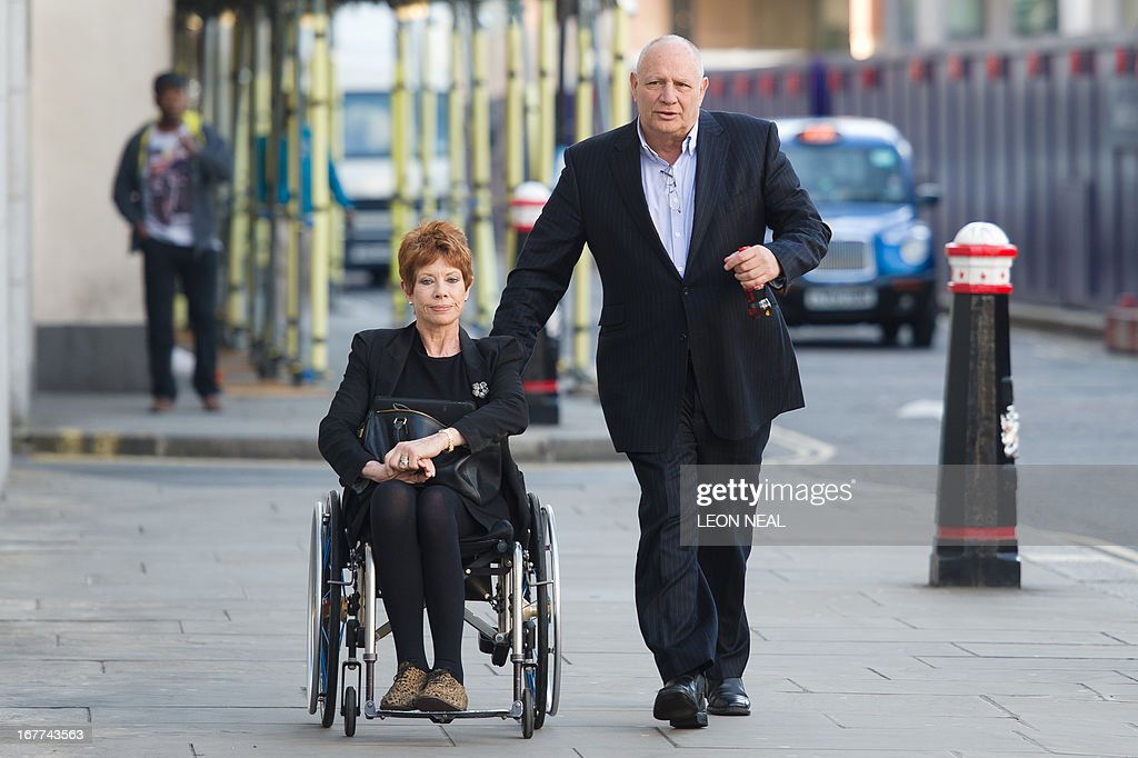 Former newspaper proprietor Eddy Shah (R) who founded the now-defunct Today newspaper, arrives with his wife Jennifer at the Old Bailey in London on April 29, 2013 to face trial accused of sexual offences against a schoolgirl in the 1990s. Shah,69, who is charged under his birth name of Selim Shah, of Chippenham, Wiltshire, denies the allegations. AFP PHOTO/Leon Neal