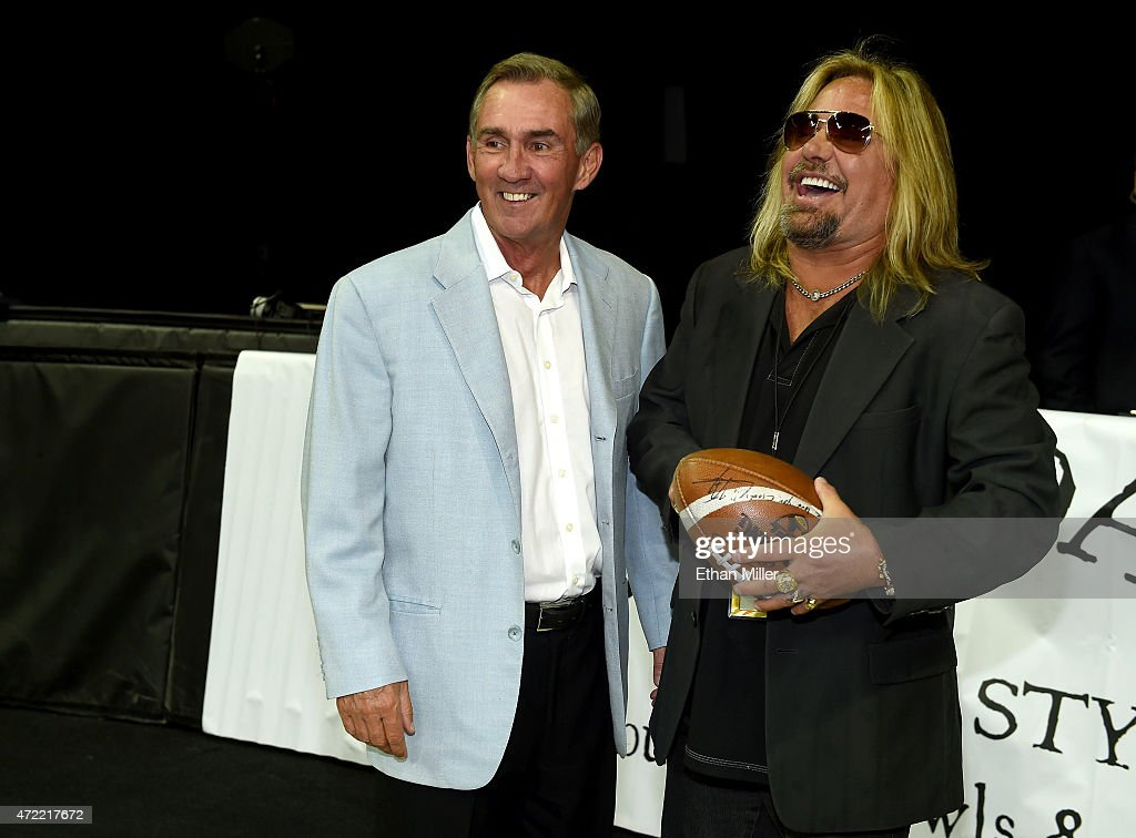 Former NFL coach <a gi-track='captionPersonalityLinkClicked' href=/galleries/search?phrase=Mike+Shanahan&family=editorial&specificpeople=213113 ng-click='$event.stopPropagation()'>Mike Shanahan</a> (L) and Motley Crue singer and Las Vegas Outlaws owner <a gi-track='captionPersonalityLinkClicked' href=/galleries/search?phrase=Vince+Neil&family=editorial&specificpeople=239521 ng-click='$event.stopPropagation()'>Vince Neil</a> laugh before the Outlaws' game against the Los Angeles Kiss at the Thomas & Mack Center on May 4, 2015 in Las Vegas, Nevada. Las Vegas won 49-16.