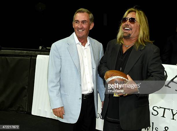 Former NFL coach Mike Shanahan and Motley Crue singer and Las Vegas Outlaws owner Vince Neil laugh before the Outlaws' game against the Los Angeles...