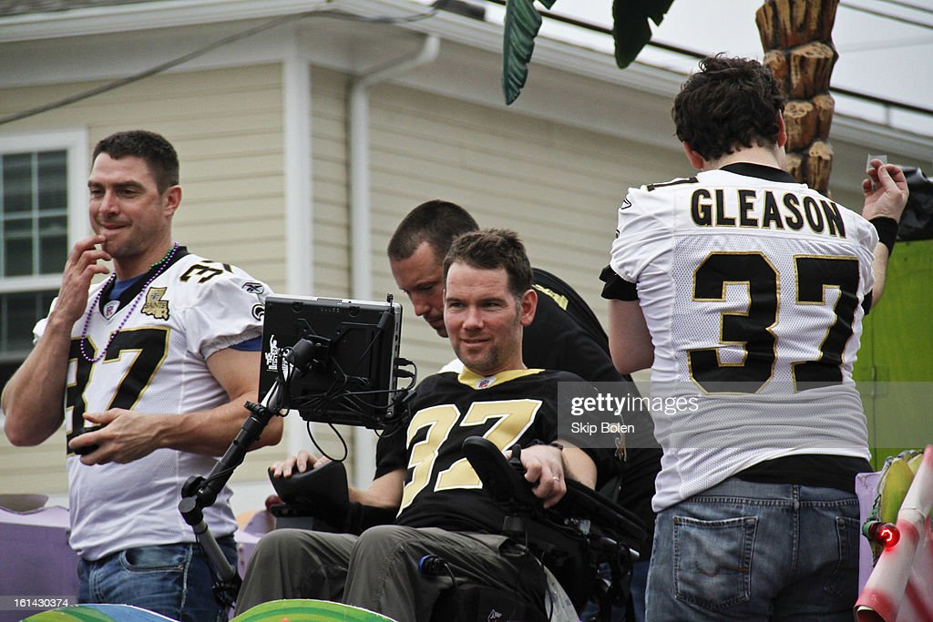 Former NFL New Orleans Saints Safety, <a gi-track='captionPersonalityLinkClicked' href=/galleries/search?phrase=Steve+Gleason&family=editorial&specificpeople=749005 ng-click='$event.stopPropagation()'>Steve Gleason</a> with friends that started Team Gleason to generate public awareness and raise funds for Amyotrophic Lateral Sclerosis rides in the 2013 Krewe of Bacchus Mardi Gras Parade on February 10, 2013 in New Orleans, Louisiana.