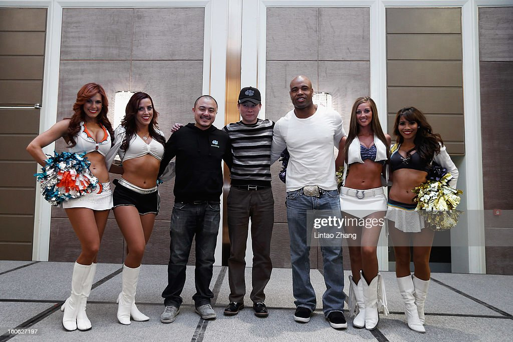 Former NFL player Akin Ayodele (3rd R) poses with Pro Bowl Cheerleaders during the official NFL China Super Bowl Party at Kerry Hotel on February 4, 2013 in Beijing, China.