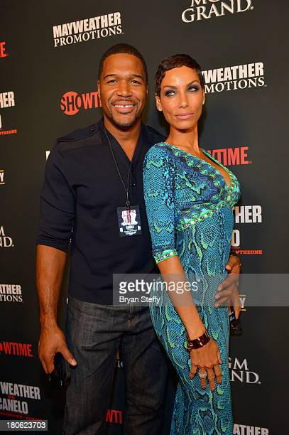 Former NFL player and current talk show host Michael Strahan and TV personality Nicole Murphy arrive at the MGM Grand Garden Arena for the Floyd...