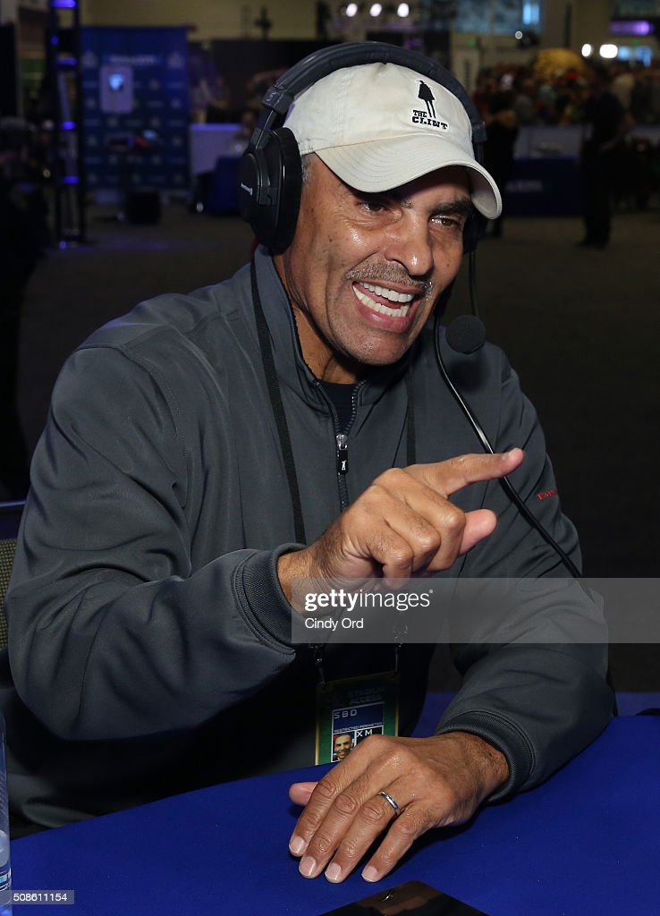 Former NFL player and head coach Herman Edwards visits the SiriusXM set at Super Bowl 50 Radio Row at the Moscone Center on February 5 2016 in San...