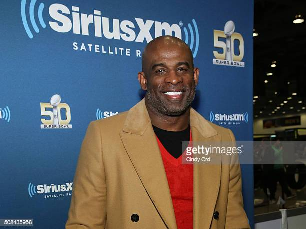 Former NFL player and sportscaster Deion Sanders visits the SiriusXM set at Super Bowl 50 Radio Row at the Moscone Center on February 4 2016 in San...