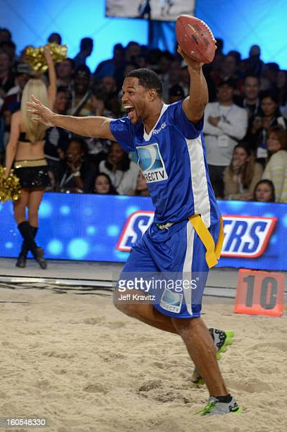 Former NFL player and TV personality Michael Strahan attends DIRECTV'S 7th Annual Celebrity Beach Bowl at DTV SuperFan Stadium at Mardi Gras World on...