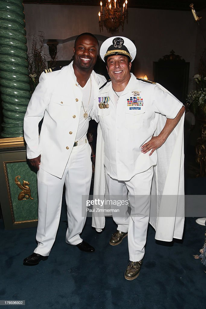 Former NFL player <a gi-track='captionPersonalityLinkClicked' href=/galleries/search?phrase=Bart+Scott&family=editorial&specificpeople=582805 ng-click='$event.stopPropagation()'>Bart Scott</a> and Sir Ivan attend Sir Ivan's Sailors and Sinners Soiree on September 1, 2013 in Water Mill, New York.