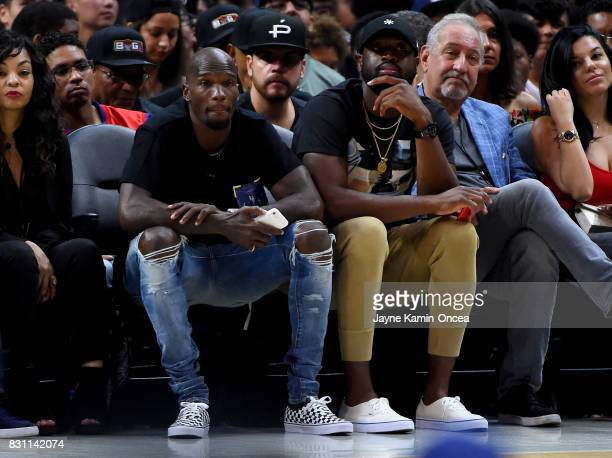Former NFL player Chad Johnson and Dwyane Wade of the Chicago Bulls watch the game between TriState and Power during week eight of the BIG3 three on...