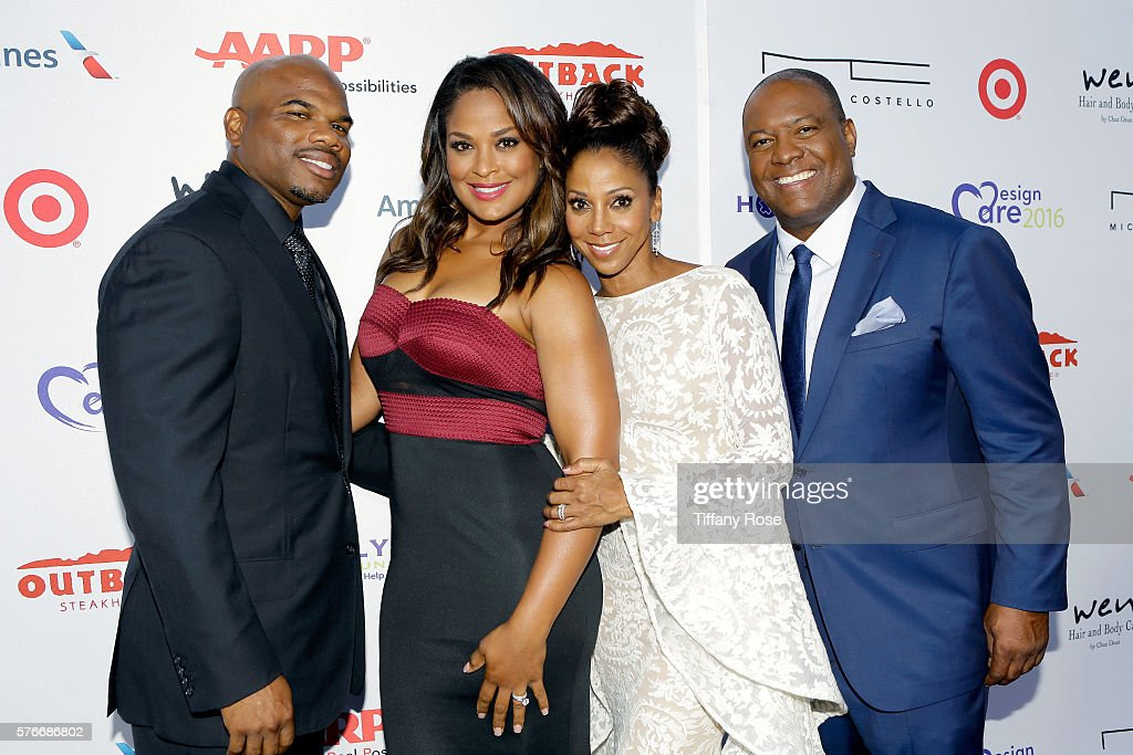Former NFL player Curtis Conway former professional boxer Laila Ali actress Holly Robinson Peete and former NFL player Rodney Peete attend HollyRod...