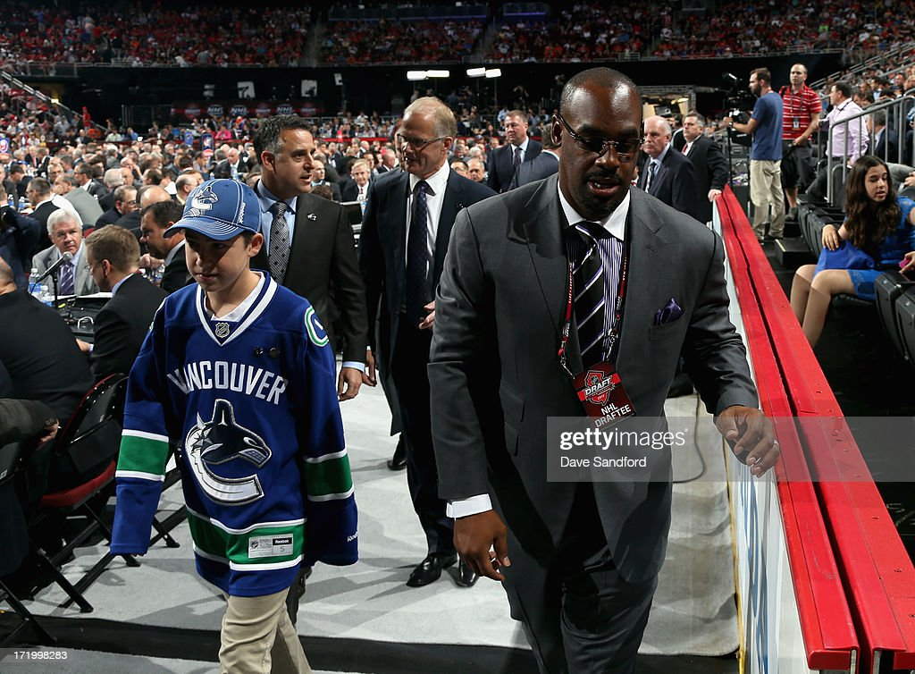 Former NFL player Donovan McNabb attends the 2013 NHL Draft at Prudential Center on June 30, 2013 in Newark, New Jersey.