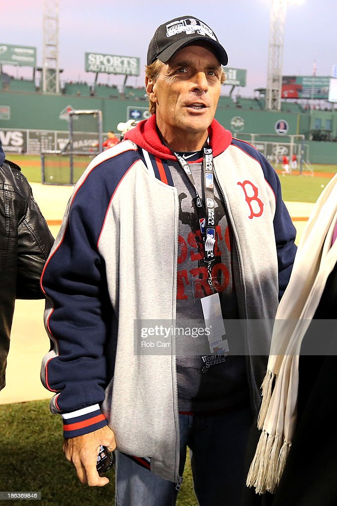 Former NFL player Doug Flutie stands on the field during batting practice before Game Six of the 2013 World Series between the Boston Red Sox and the...